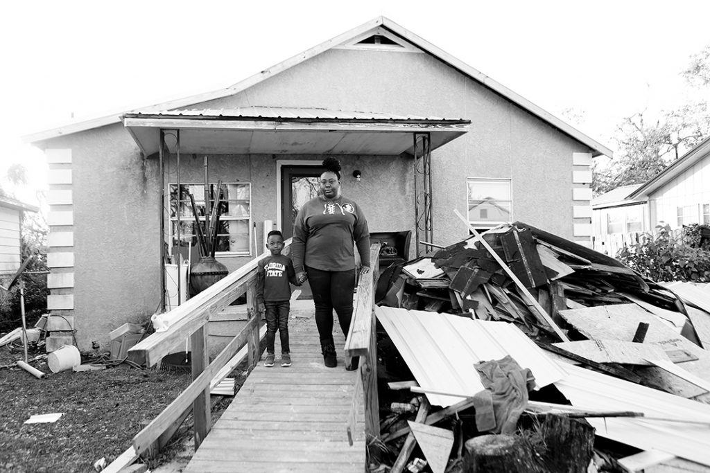 Celissia and Cameron outside their gutted home