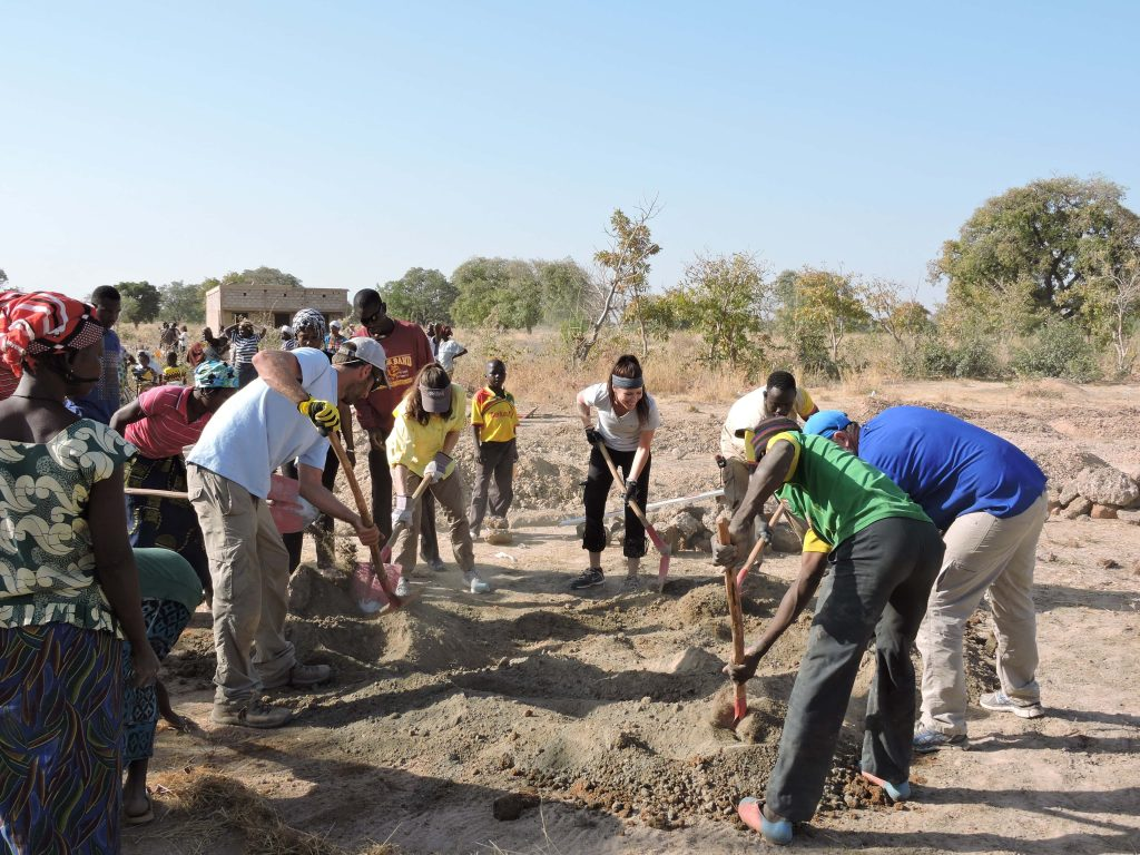 Working on the school worksite on the first buildOn School-building trip to Burkina